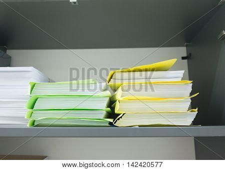office folders with in the gray shelf
