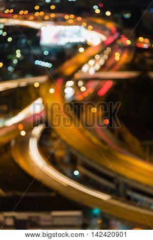 Blurred bokeh lights close up highway interchanged, abstract background