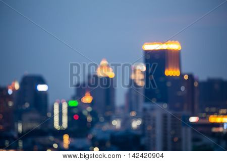 Abstract blurred bokeh lights night view, city office tower background