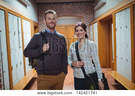 Portrait of mature students standing in the corridor