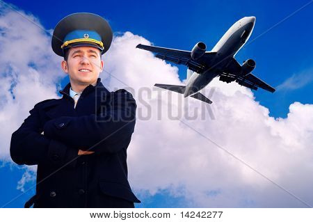 Pilot and airplane in the sky
