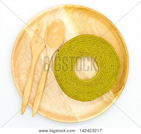 Green tea layer cake on wooden plate