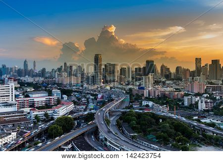 City downtown and highway interchanged with sunset background