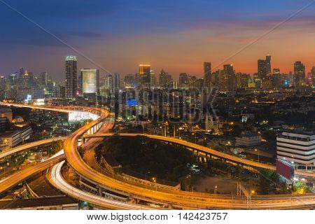 Sunset background over city downtown and highway interchanged