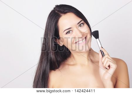 Closeup Of Young Caucasian Woman Applying Makeup