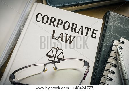 Corporate law book. Justice and legislation concept.