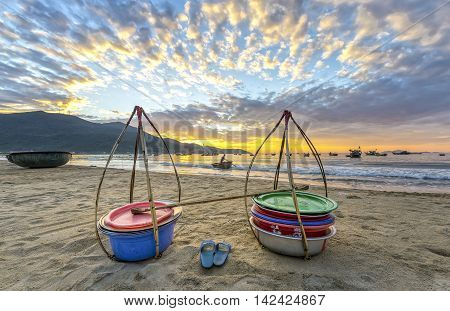 Da Nang, Vietnam, June 26th, 2015: Double strickle, slippers expected to welcome the new day afar who came back, this is the vehicle for trafficking fishermen fish in waters so simple, rustic but rich emotional meaning of life