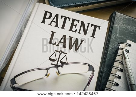 Patent law book. Justice and legislation concept.