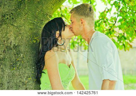 The nice guy kisses the girl the brunette