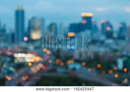 Blurred bokeh lights night view, office building, abstract background