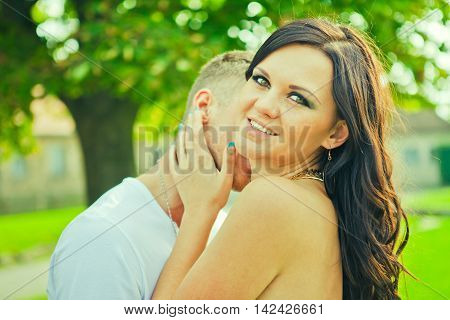 The guy with the girl gently embrace