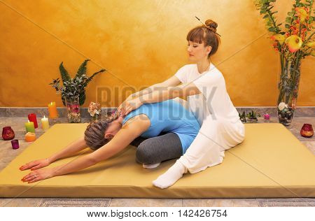 Women practicing physical energy flexibility exercise indoor