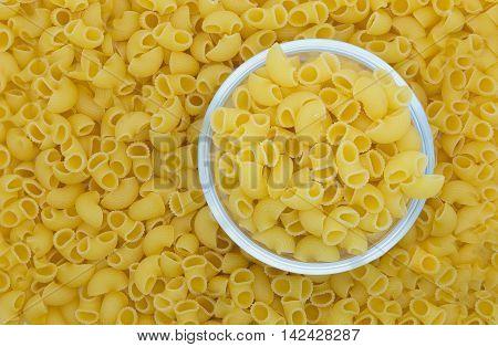 Italian Macaroni Pasta on glass blow and background