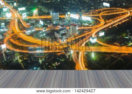 Opening wooden floor, aerial view Bangkok highway interchanged night view, Thailand