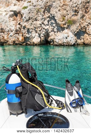Scuba diving equipment and fins on a boat
