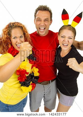 Photo of three people cheering for Germany wearing shirts with the colours of the German flag.