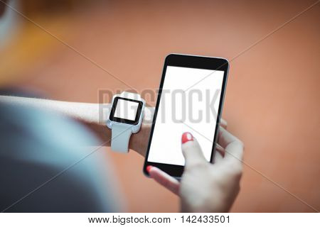 Close-up of mature student using mobile phone at college