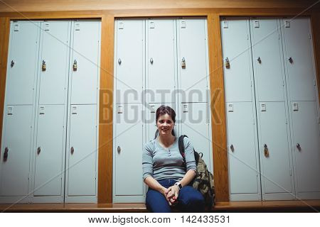 Portrait of mature student sitting in the locker room at college