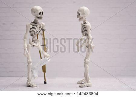 Broken leg skeleton chatting with his friend