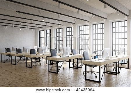 Large office room with lots of computer desks and big windows. Wooden floor. Good lightning. Concept of corporate work. 3d rendering
