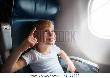 Boy Airplane Window Show Finger Up Travel Toned