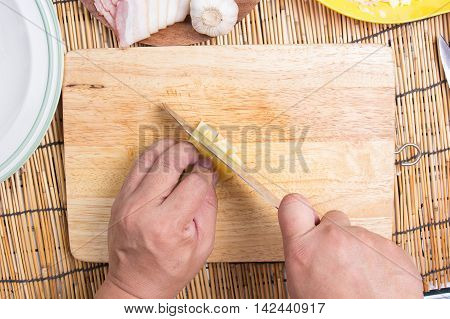 Chef cutting cheese with knife before cooking / cooking spaghetti concept