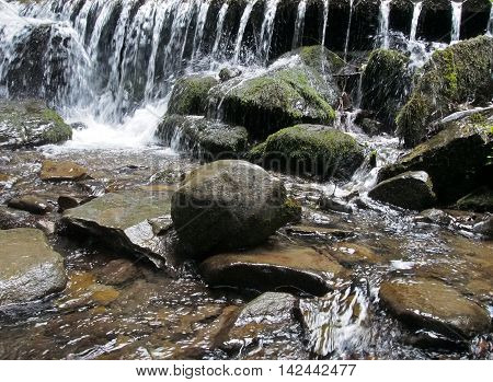 Picturesque falls and thresholds on the crystal-clear mountain river in Carpathians Mountains, Ukraine