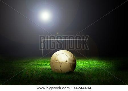 Fußball auf dem Feld des Stadions mit Licht