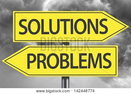 Solutions x Problems yellow sign