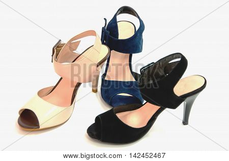 Three womens open-toe sandals isolated on white.
