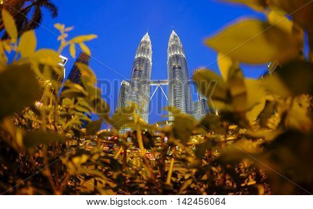 KUALA LUMPUR, MALAYSIA - MAY 25, 2014: Petronas Twin Towers during blue hour sunset. Petronas Twin Towers also known as KLCC (Kuala Lumpur City Centre).