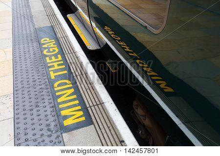 Mind The Gap Warning On A Station Platform
