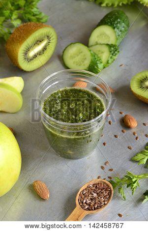 Healthy green smoothies with ingredients. Detox vegetarian diet concept, vertical