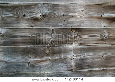 Old weathered gray background of knotted wood