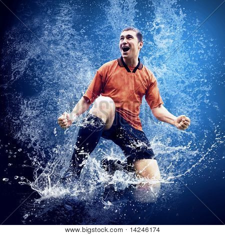 Water drops around football player under water on blue background