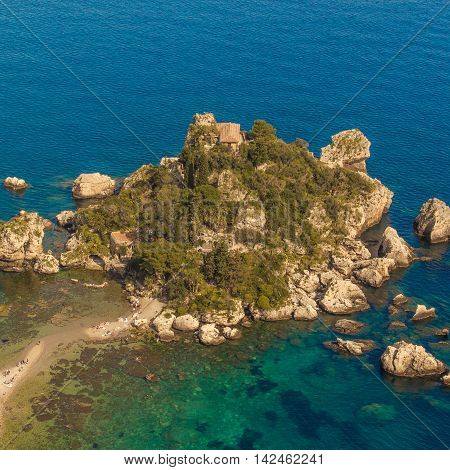 Italy Taormina - Sicily. Aerial view of Isola Bella's island and beach on blue mediterranean water.