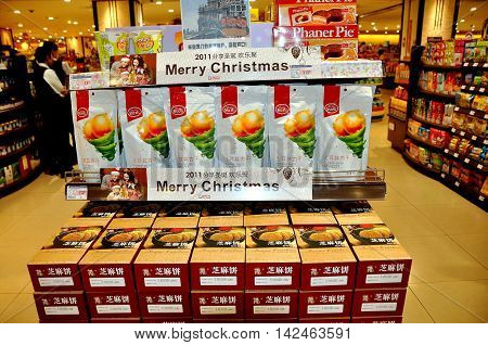 Chengdu China - November 22 2011: A Christmas display for Turkish dired apricots in both English and Chinese at an upscale Ito Yokado supermarket