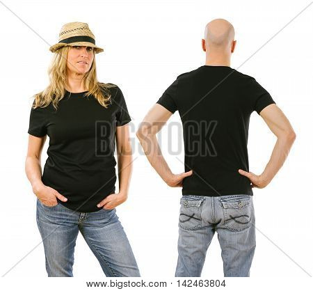 Photo of a woman and a man posing with a blank black t-shirt ready for your artwork or design.