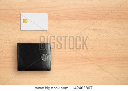 Wallet and credit card on desk top view