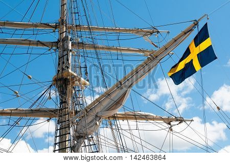 Masts of the old sailing ship on sky background