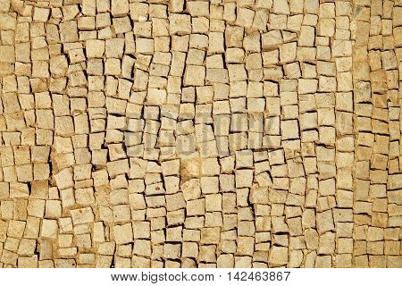 Background of ancient stone tiles mosaic floor