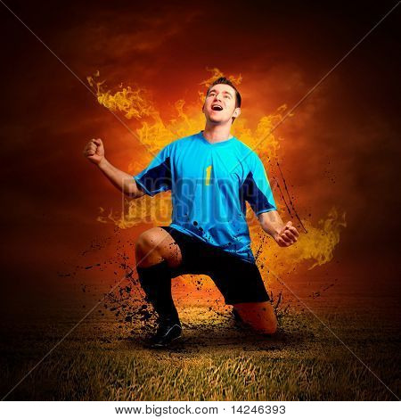 Football player in fires flame on the outdoors field