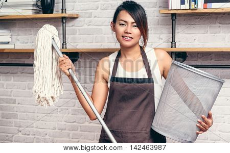 Asian women are trash mop the floor.