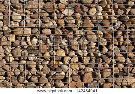 Pile Of Stones Behind Metal Grid.