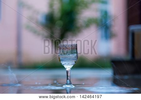 glass of water in the rainy weather outdoors