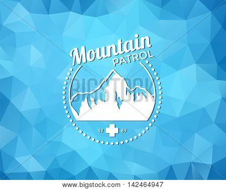 Vintage skiing resort or mountain patrol label, emblem or logo with mountain and cross on blue ice background