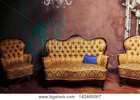 Classical interior with an armchairs and sofa