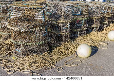 Lobster nets with other sea fishing gear such as ropes and plastic buoys.