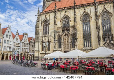MUNSTER, GERMANY - AUGUST 7, 2016: Cafe at the historical Prinzipal market square in Munster, Germany