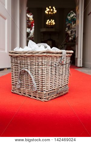 Vintage wicker wooden basket outdoor setting, red carpet